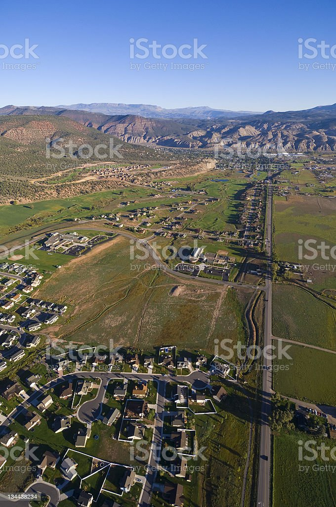 Aerial View of Urban Sprawl Encroaching on Rural Land royalty-free stock photo