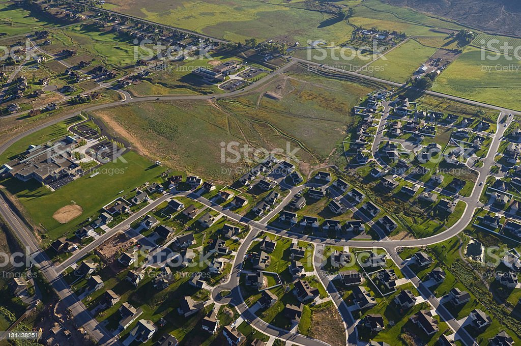 Aerial View of Urban Sprawl Encroaching on Rural Land stock photo
