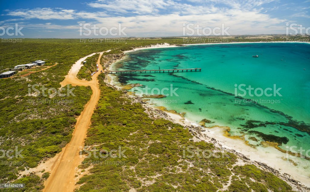 Aerial view of Vivonne Bay pier and vivid turquoise ocean water, Kangaroo Island, South Australia stock photo