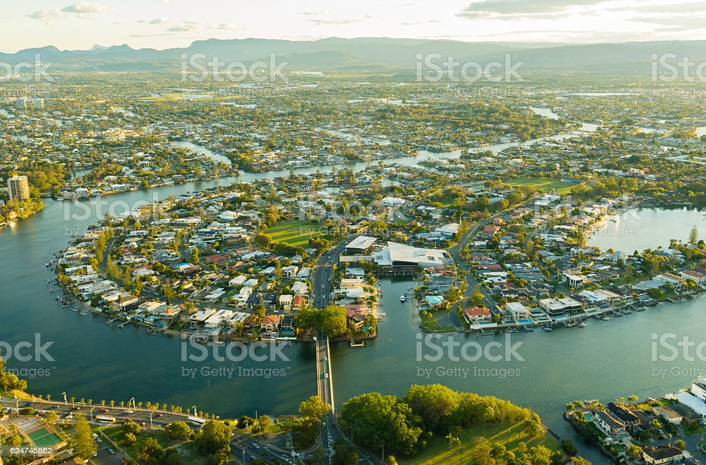 Aerial view of waterfront houses during sunset stock photo