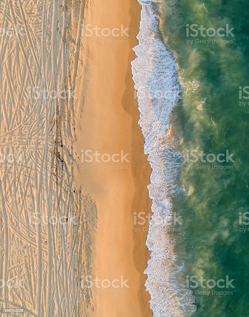 Aerial View of where Waves meet the Pattern Sandy Beach stock photo