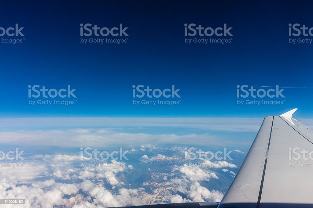 Aerial View of white clouds, blue sky and aircraft wing stock photo