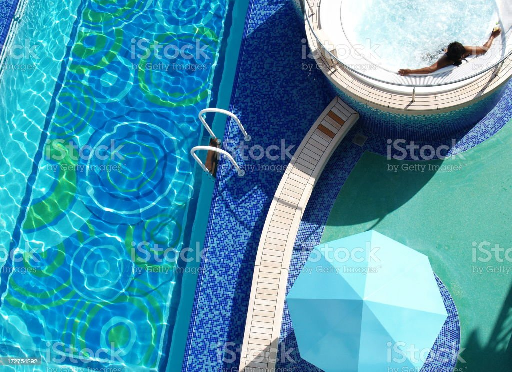 Aerial view of woman in a poolside Jacuzzi royalty-free stock photo
