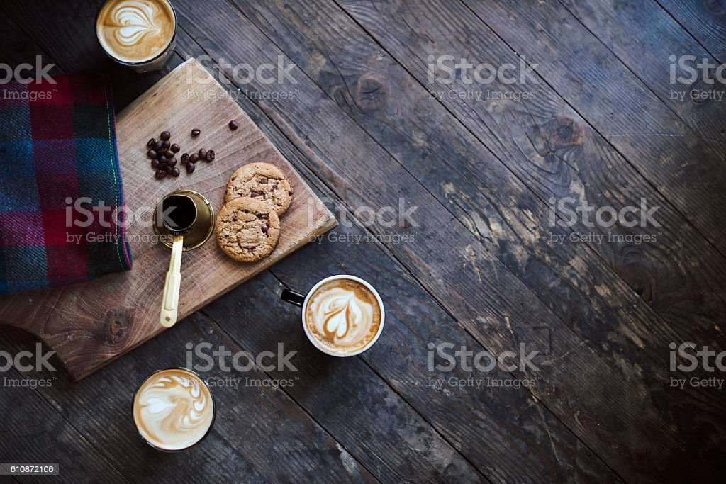 Aerial view of wooden table with coffee cups stock photo