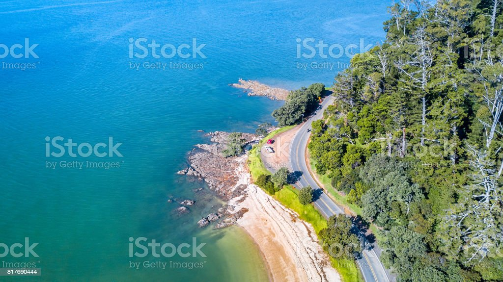 Aerial view on a road running along sea shore. Auckland, New Zealand. stock photo