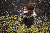 Aerial view on a woman and yellow leaves
