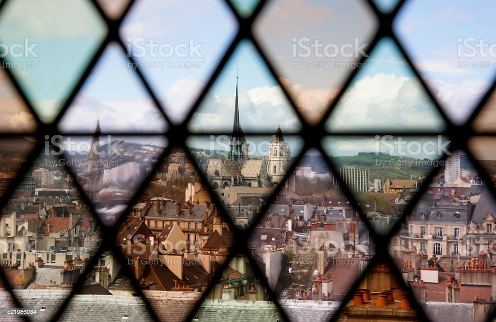 Aerial view on Dijon through old stained glass stock photo
