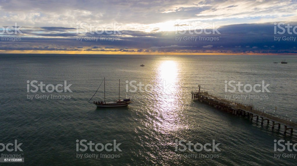 Aerial view on sailing ship and pierce stock photo