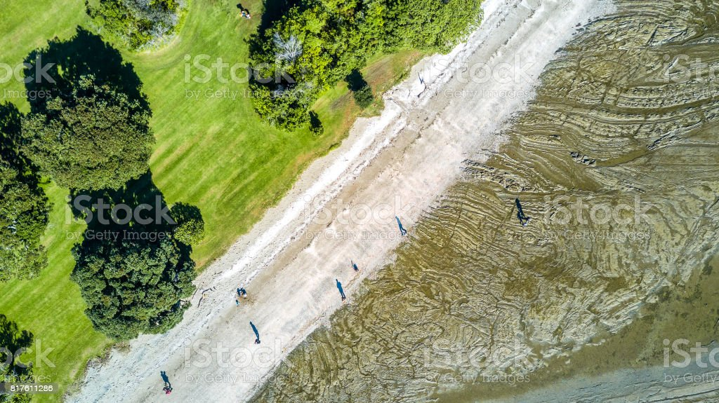 Aerial view on sunny beach at a low tide. Auckland, New Zealand stock photo