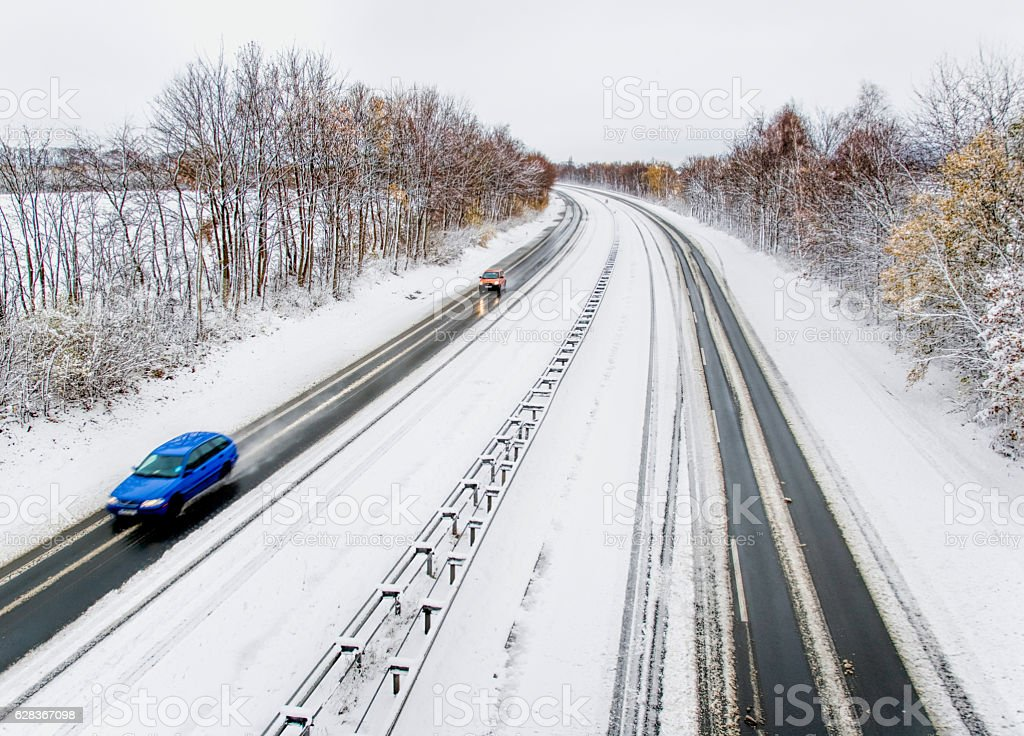Aerial view on treelined Highway in snow stock photo
