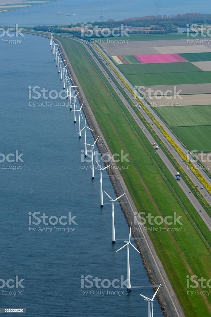 Aerial view on wind turbines and fields of tulip flowers stock photo