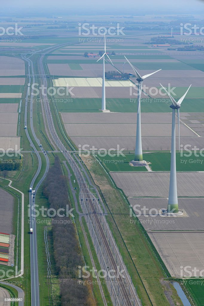 Aerial view on wind turbines next a railroadtrack and highway stock photo