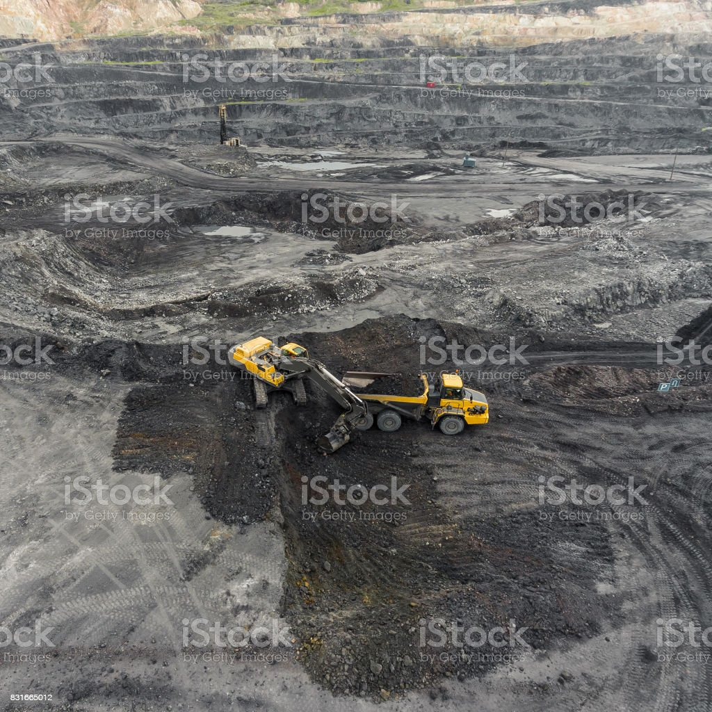 Aerial view open pit mine, loading of rock, mining coal, extractive industry stock photo
