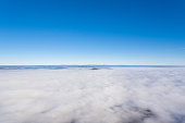Aerial view over a sea of fog