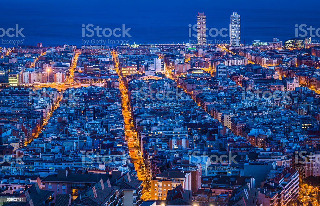 Aerial view over city lights at night Mediterranean Barcelona Spain stock photo