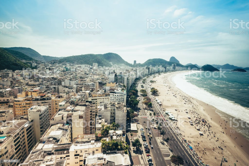 aerial view over copacabana with mountains and sea stock photo