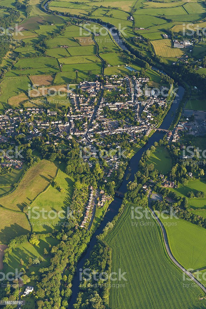Aerial view over country town green summer fields stock photo