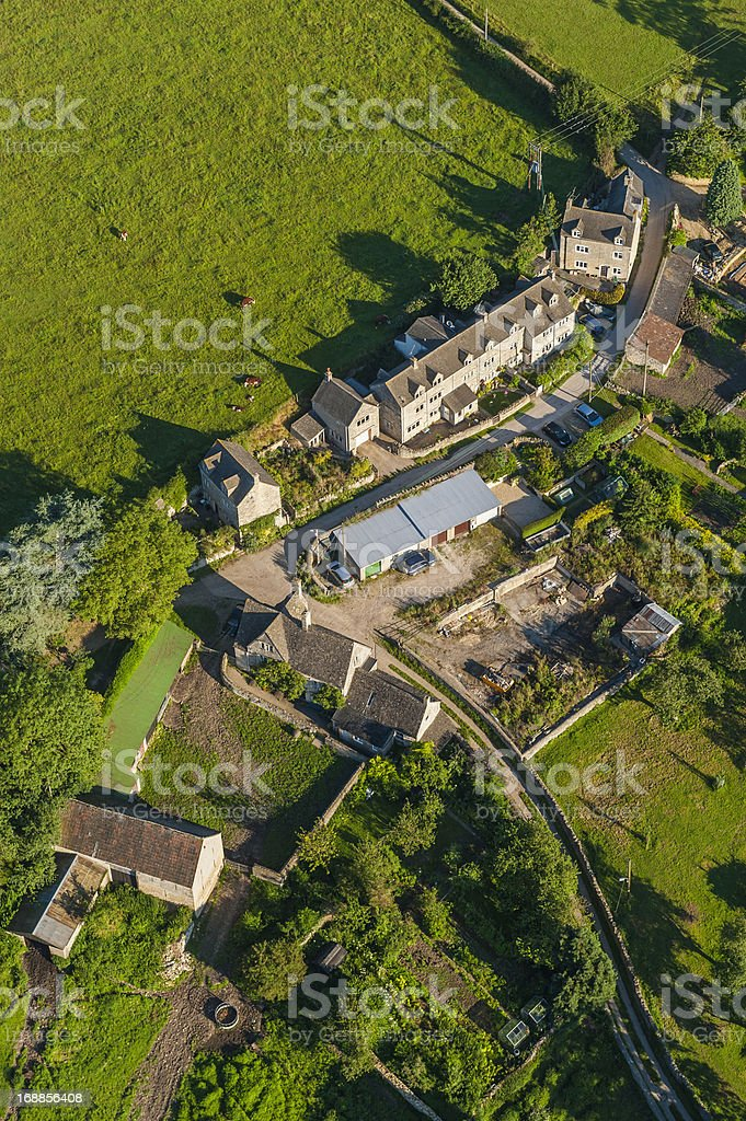 Aerial view over farmhouse barns and green pasture royalty-free stock photo