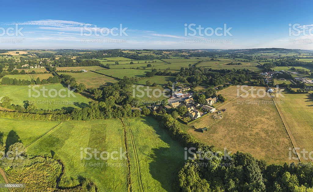 Aerial view over farms fields villages in idyllic green countryside royalty-free stock photo