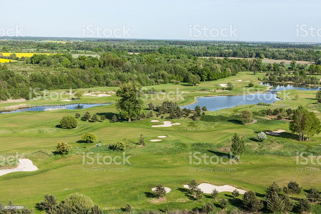 Aerial view over golf field stock photo