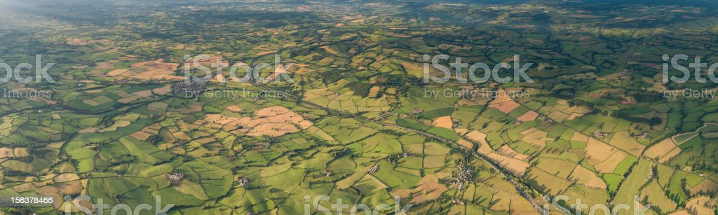 Aerial view over green patchwork landscape panorama stock photo