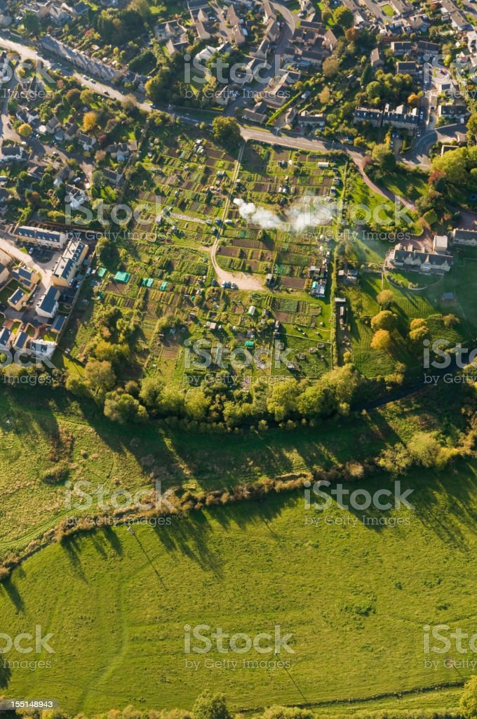 Aerial view over homes gardens summer fields royalty-free stock photo