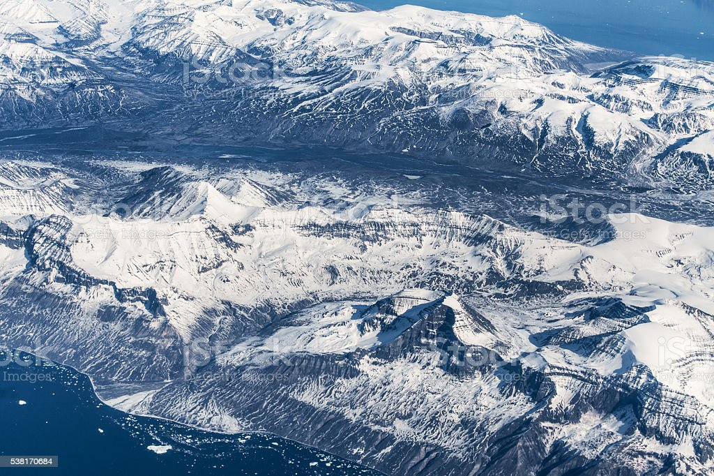 Aerial view over ice mountains in Greenland stock photo