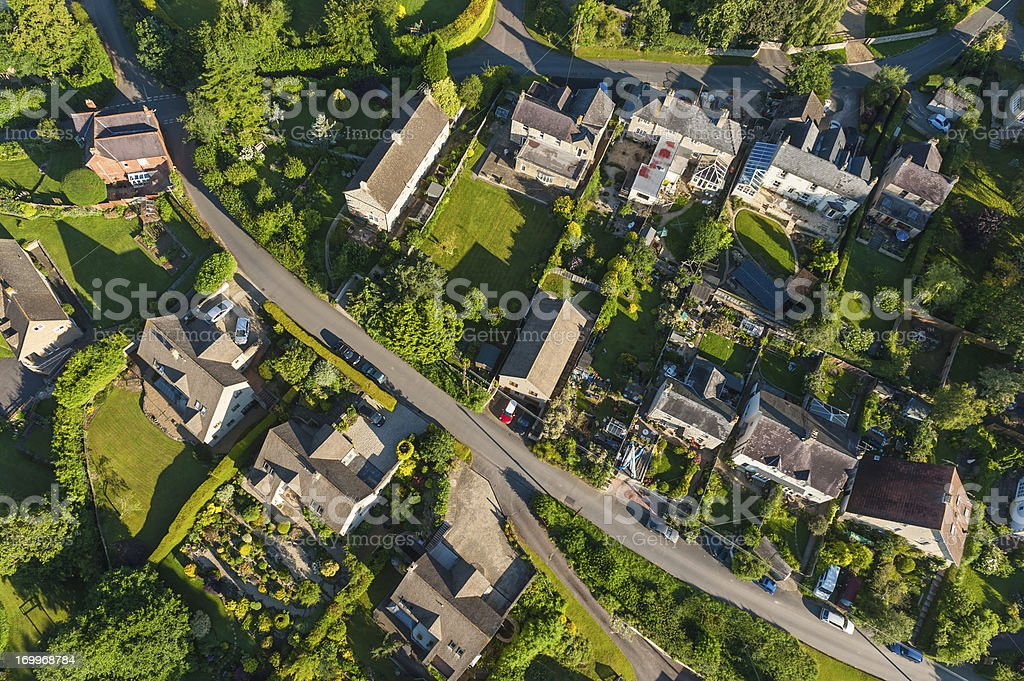 Aerial view over picturesque country homes green summer gardens stock photo