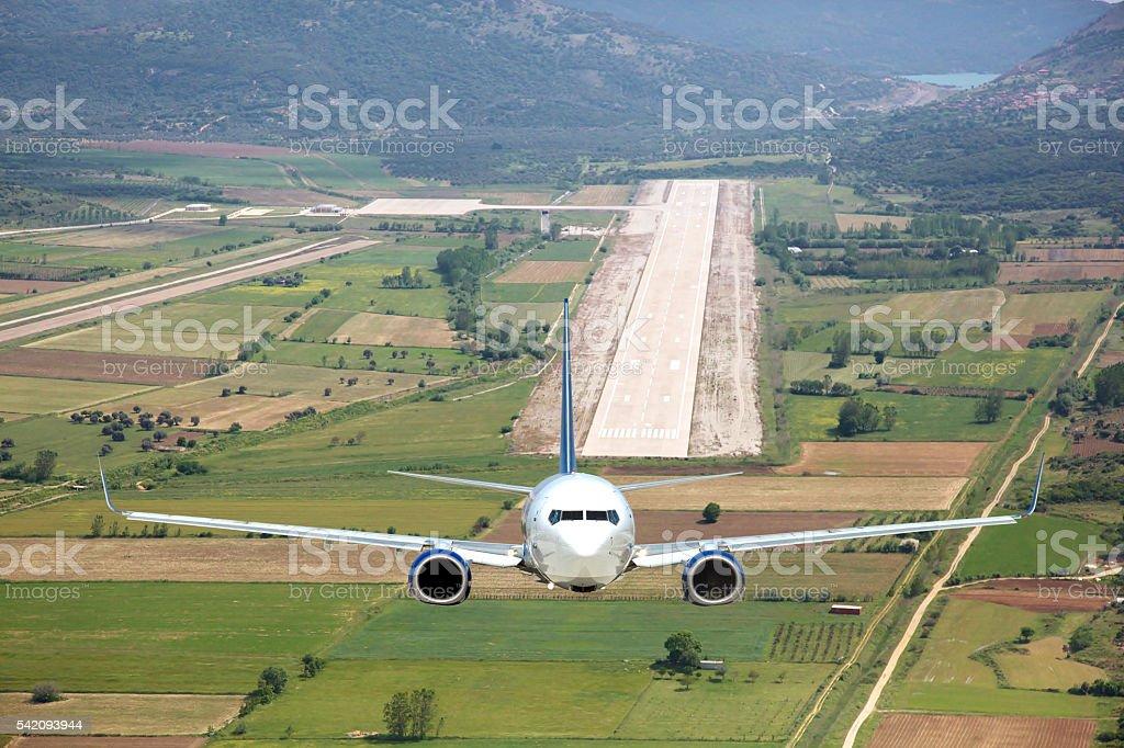 Aerial view passenger plane take off stock photo