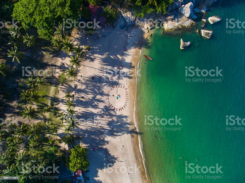 Aerial view people on the beach stock photo