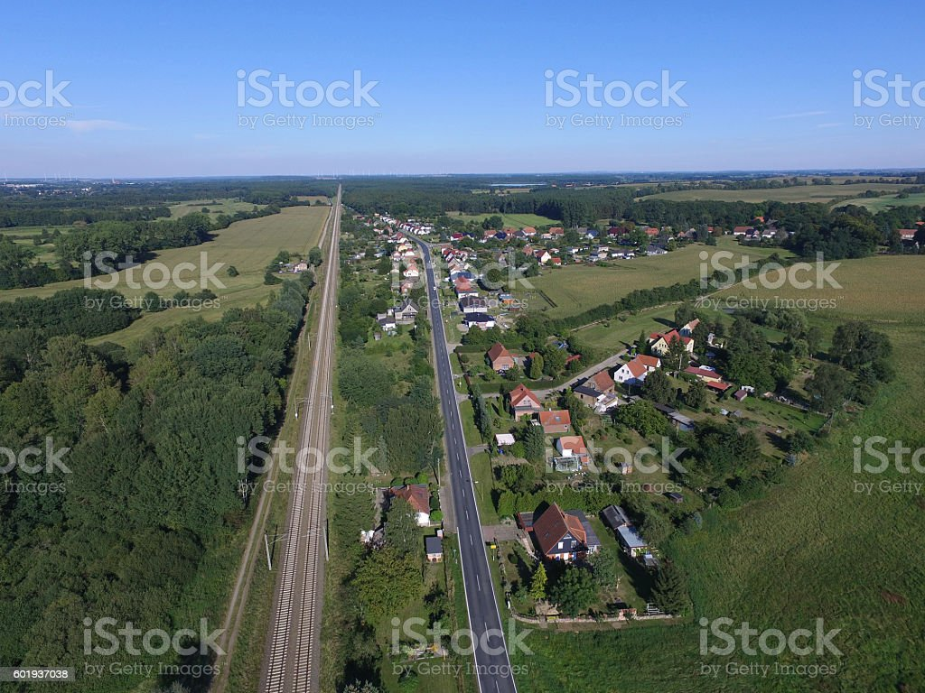 aerial view - small village next to a railroad track stock photo