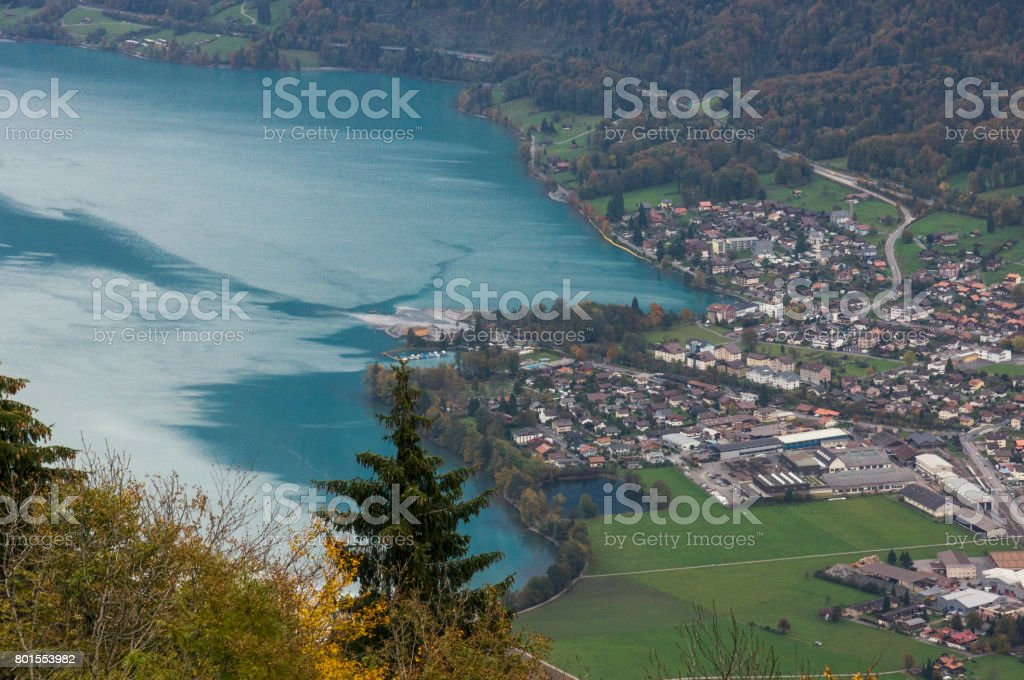 Aerial view to the beautiful blue lake and alpine town stock photo