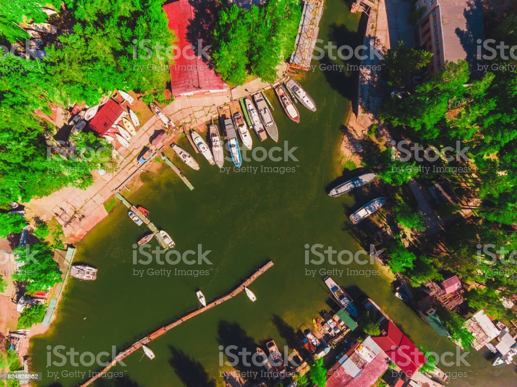 Aerial view to the boat station in lagoon Moored boats and yachts stock photo