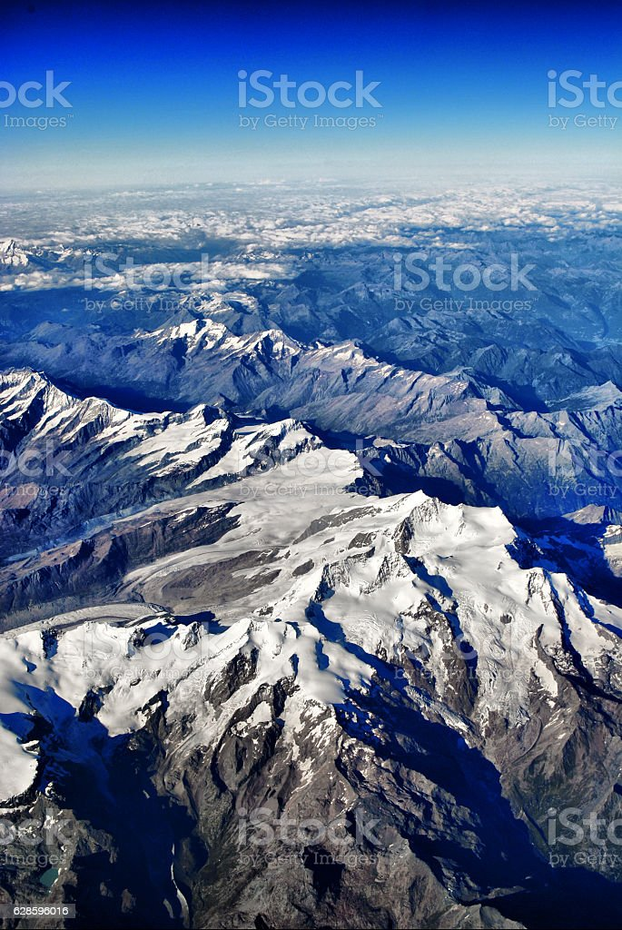Aerial views of snow mountains in Alpen stock photo