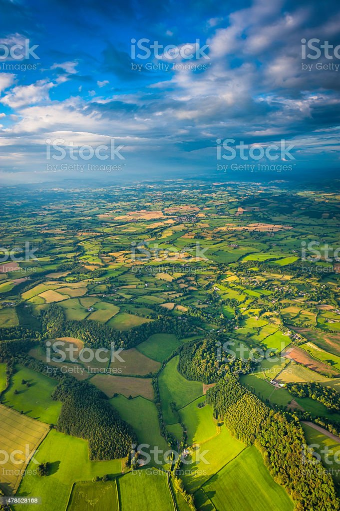 Aerial vista across green summer landscape under big country skies stock photo