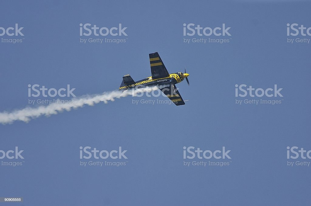 Aerobatic Airplane Trailing Smoke royalty-free stock photo