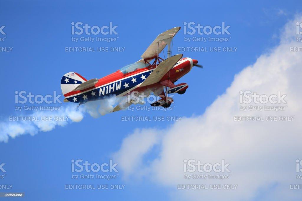 Aerobatic biplane in action royalty-free stock photo