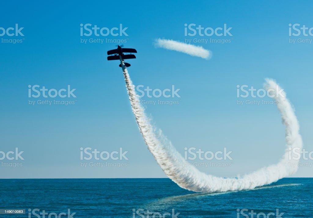 Aerobatic biplane on the sky royalty-free stock photo