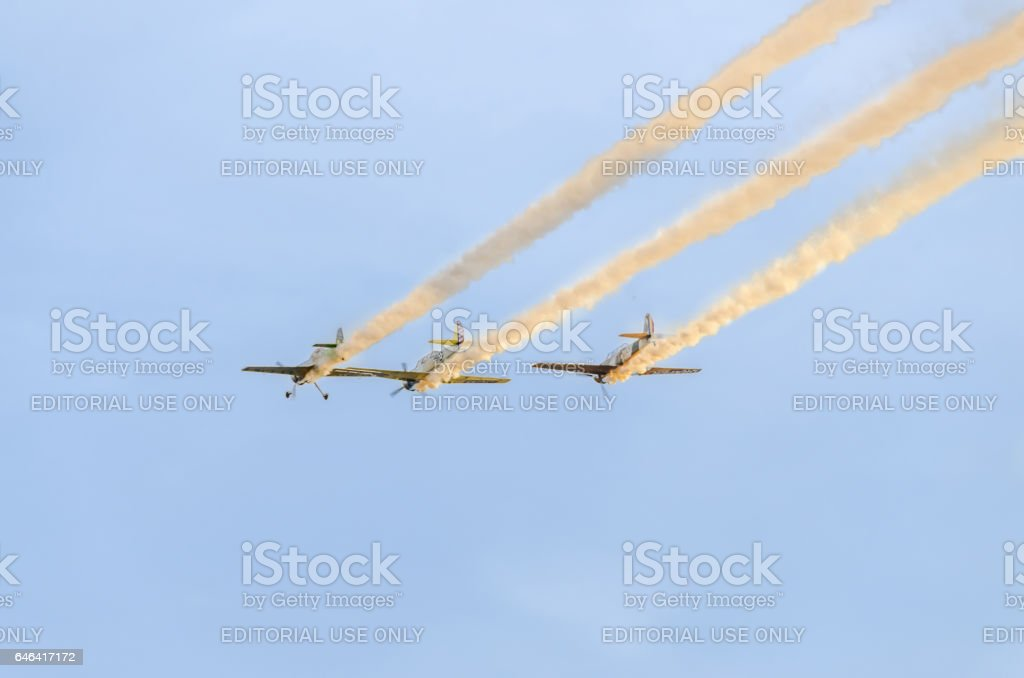 Aerobatic pilots training in the blue sky, colored trace smoke stock photo