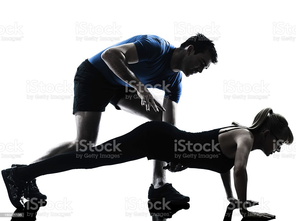 aerobics intstructor  with mature woman exercising stock photo