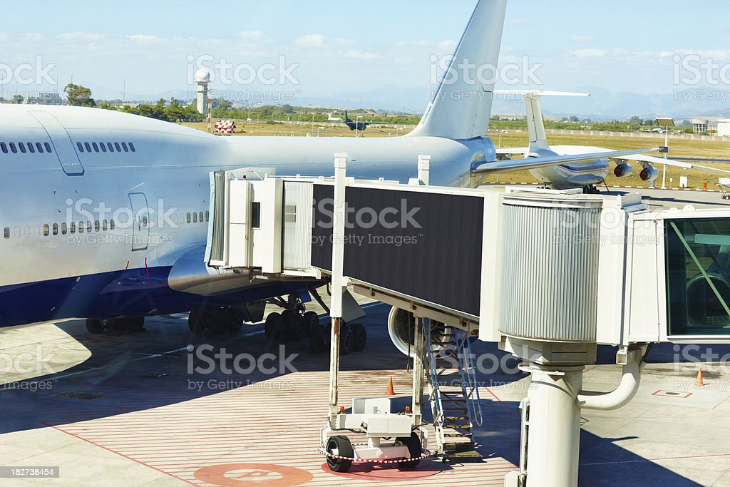 Aerobridge docking with an aircraft stock photo