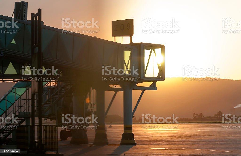 aerobridge plane parked in sunset stock photo