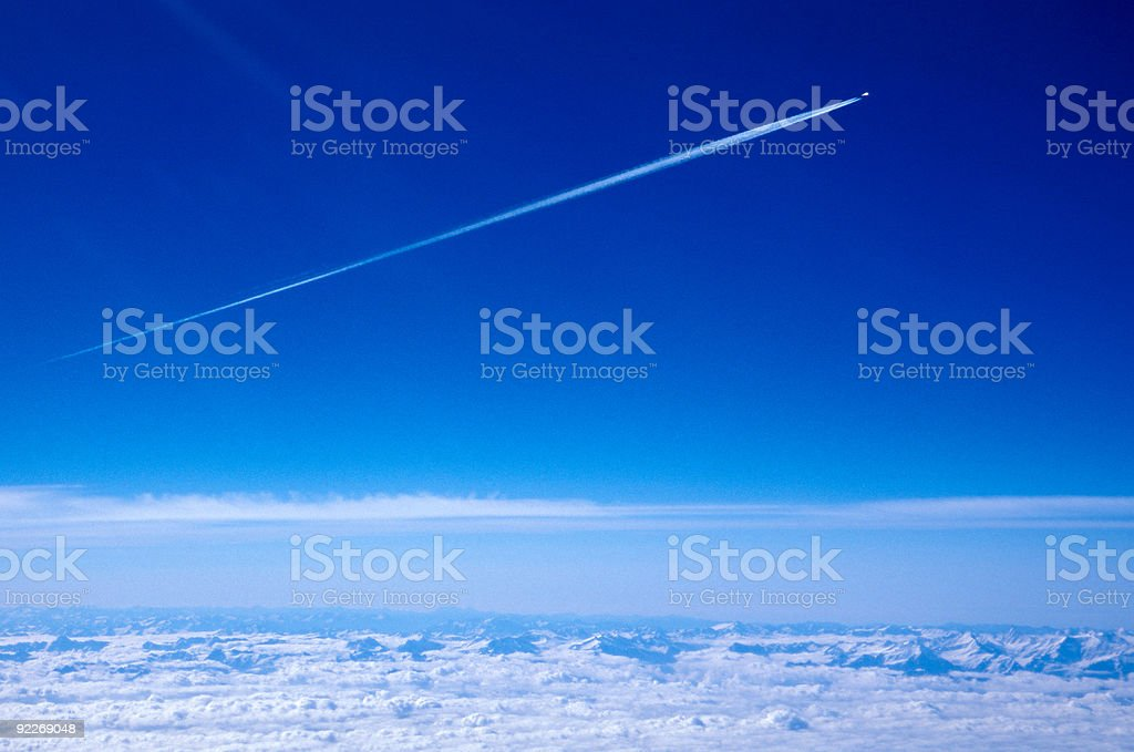 Aeroplane and condensation trail stock photo