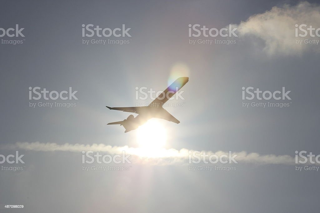 Aeroplane passing the sun royalty-free stock photo