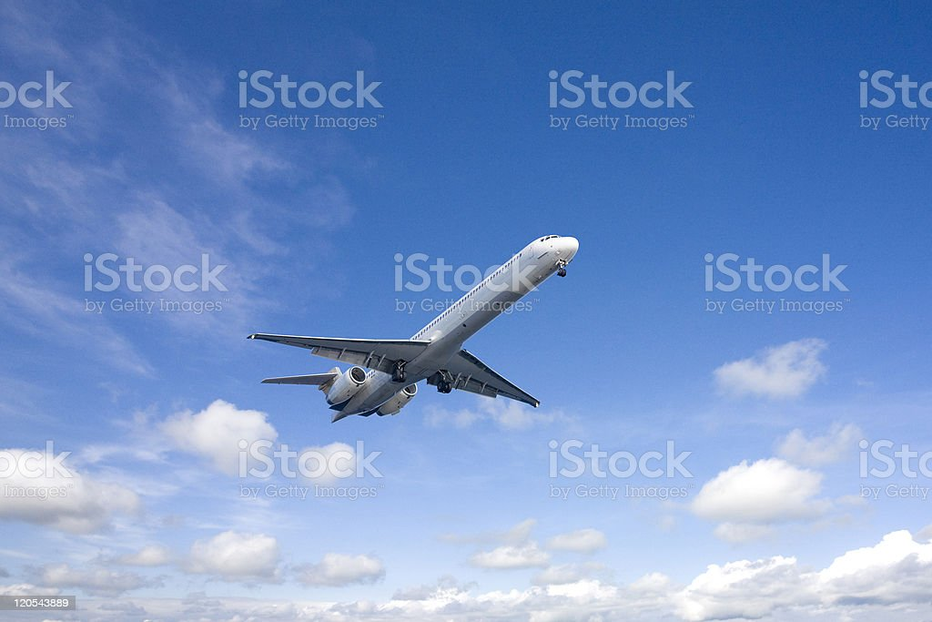 Airplane flying in the blue sky stock photo