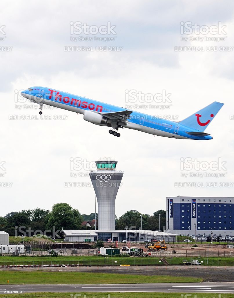 Aeroplane taking off over control tower, Birmingham. stock photo