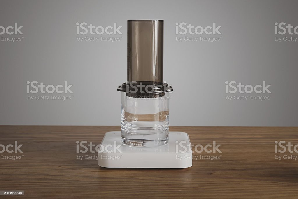 Aeropress mounted on transparent glass stock photo