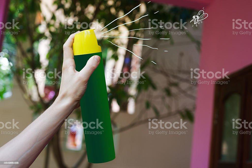 Aerosol in hand for kill mosquito stock photo