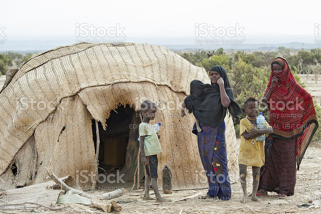 Afar women and kids in front of typical house, Ethiopia royalty-free stock photo