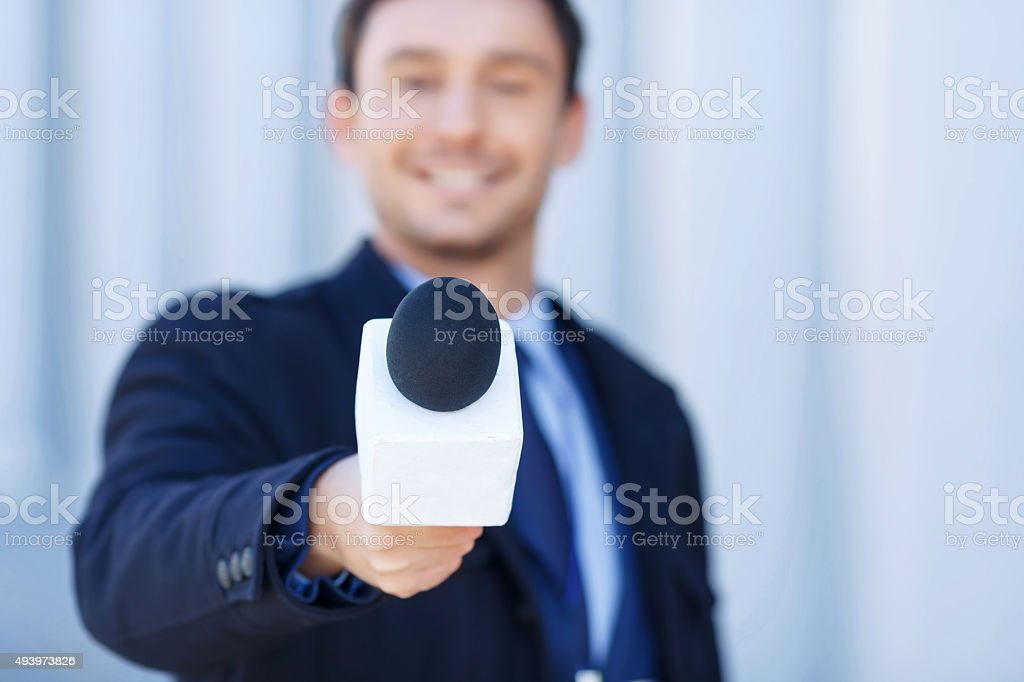 Affable newsman is listening to the interviewed stock photo